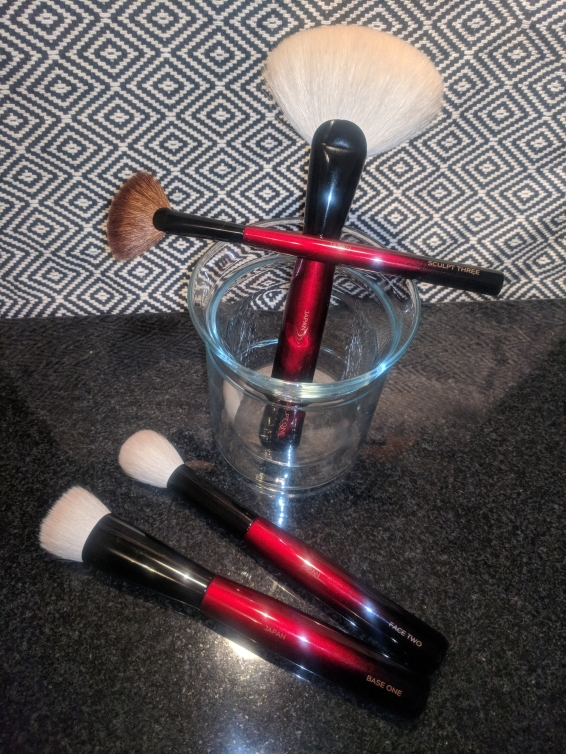 In the cup: the Sculpt Three fan brush lying across the larger Sculpt One fan brush.